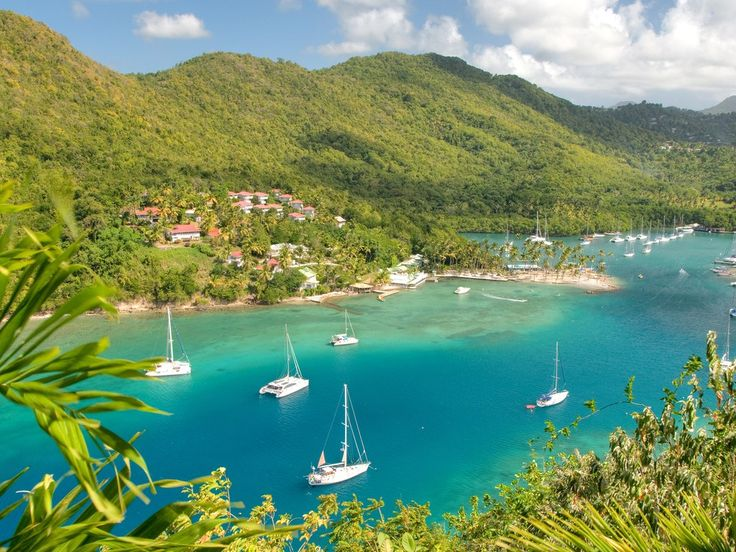 "According to our readers, Marigot Bay is ""stunning"" and ""a must-see."" The beach is also a historic landmark, having once been the site of battles between the French and British navies—though it's so calm and serene you'd never know it."