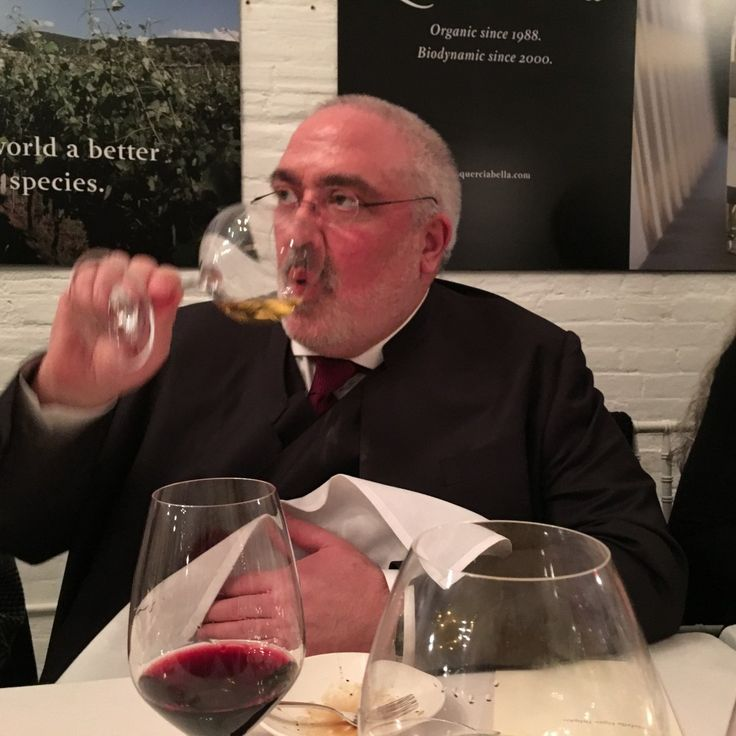 Sebastiano Querciabella tastes one of his wines at a vegan tasting dinner he organized in Manhattan. Photo by Robin D. Schatz