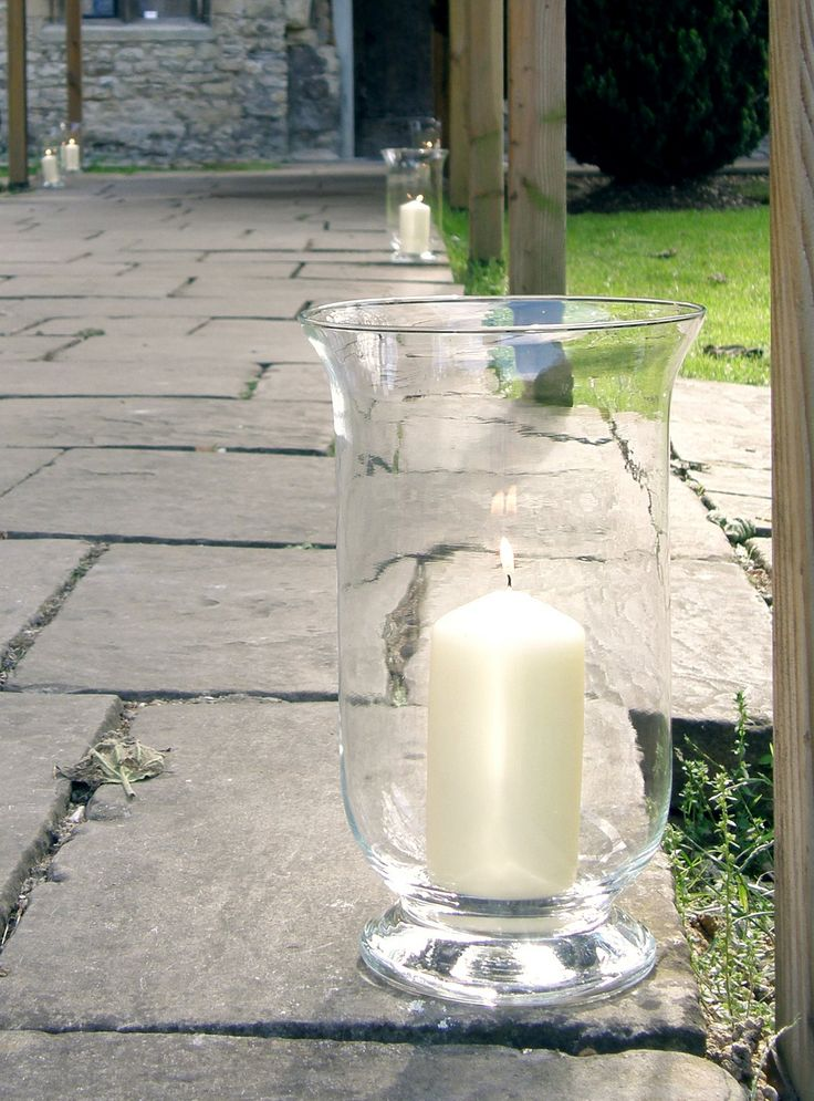Notley Abbey Bucks- Storm lanterns with large pillar candles by www.stressfreehire.com #venuetransformers