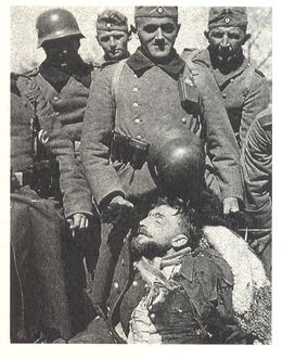 German Soldiers with body of dead Hubal, April 30th, 1940.