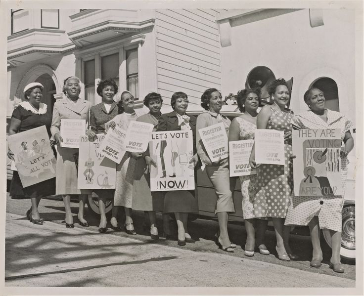 Photograph of women activists with signs for voter registrations. Collection of the Smithsonian National Museum of African American History and Culture.