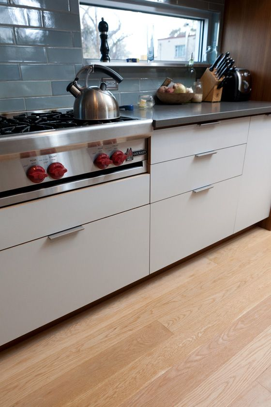 White Oak can be quite pale naturally, particularly if sorted for light colored planks only.  All 5 inch planks create a contemporary vibe for this kitchen.
