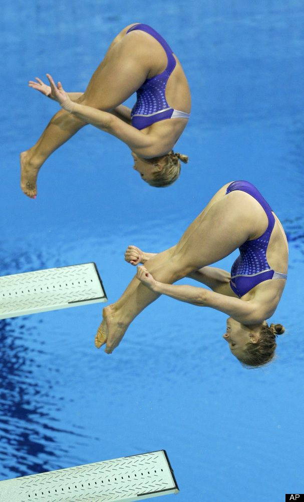 US Silver medalists Abigail Johnston, front, and Kelci Bryant, rear, compete during the 3 Meter Synchronized Springboard final at the Aquatics Centre in the Olympic Park during the 2012 Summer Olympics in London, Sunday, July 29, 2012.