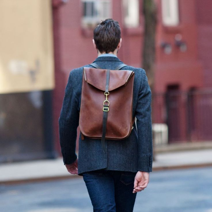 Leather Postal Backpack by Kika. Rocking the suit and ...