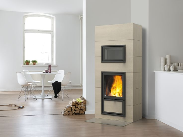 Lentua heat-retaining corner fireplace with a stew bakeoven, which can be placed on both sides of the fireplace. The vertical full-sized and full-bodied tiles are of high-quality. Read more at www.tulikivi.fi