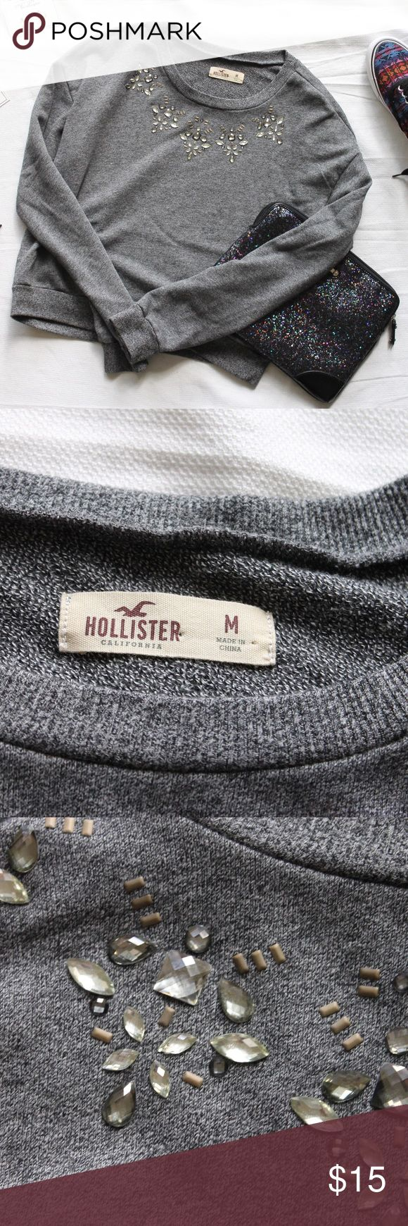 """Hollister • Cropped, Marled, Embellished Sweater It's adjective central up in here, you guys. But for real, this sweater has it all - a slightly cropped cut, marled gray color, long sleeves, jeweled neckline, and an ungodly soft material. Looks super cute dressed up with a skirt or thrown over some jeans. Approximate measurements laying flat: pit to pit 18.5"""", waist 18, length 20. Excellent condition, only worn a few times. Hollister Sweaters Crew & Scoop Necks"""
