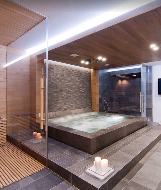 A sauna, a spa and a steam room is luxury! The day spa at home is achieved in a modern and warm palette of natural timber and stone. Photo credit- Stimamiglio, Concept Luxury Design