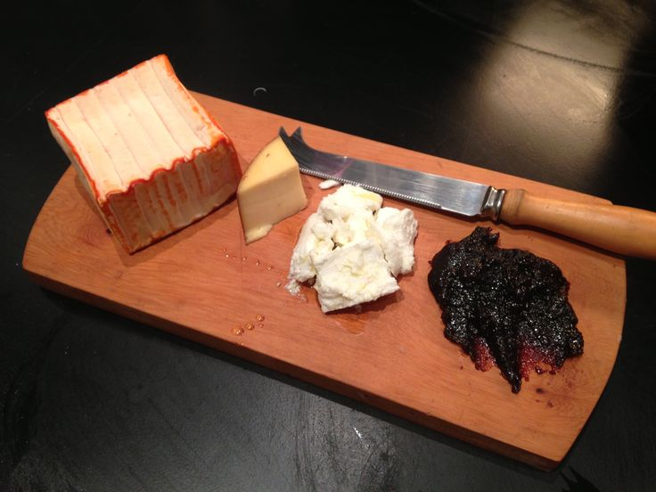 Appetizers soft posh smelly French cheese, goats cheese with black truffle oil & Pinot paste