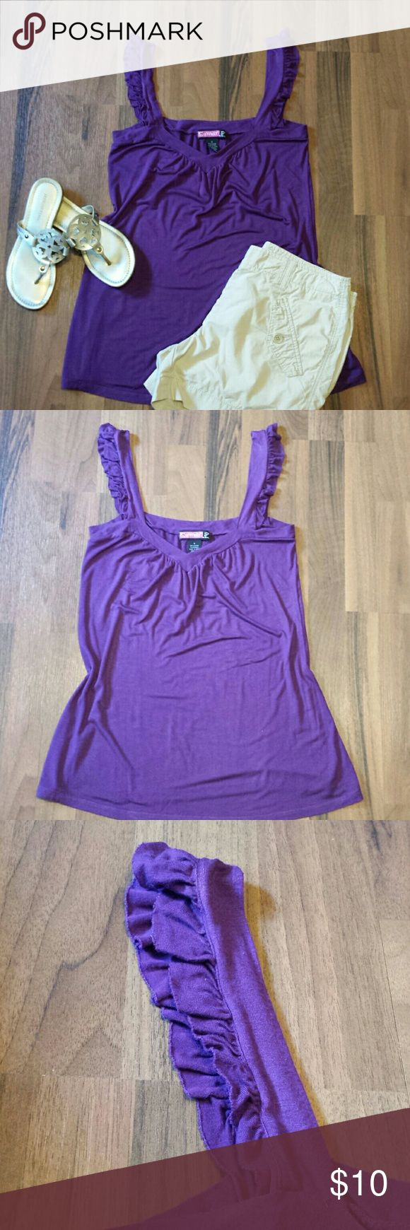 🔸5/$25🔸Purple Tank Top This cute, long & flowy tank top is great for a hot Summer day! It has pretty ruffled straps on each shoulder. Looks great with Chino shorts or denim! Great condition, no holes or stains & just a bit of pilling that naturally occurs after a wash & wear.  95% Viscose & 5% Spandex makes it stretchy & comfortable!  Measurements: Length 30 & Bust 17 Tops Tank Tops