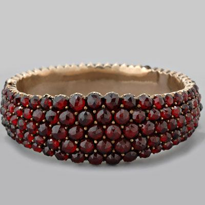 Bohemian Garnet - Multiple strands of garnet necklaces and bracelets worn on both hands predominated the garnet jewelry market, the latter enhanced by the common belief that wearing garnet bracelets would help the circulation and cleansing of blood.