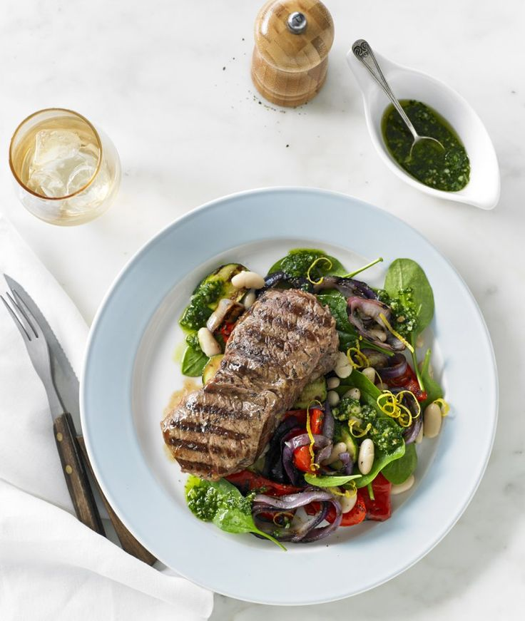Chargrilled sirloin steak with grilled vegetables, cannellini bean and pesto salad