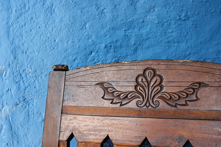 Swahili carving detail on a handcrafted wooden chair www.thekenyaway.com