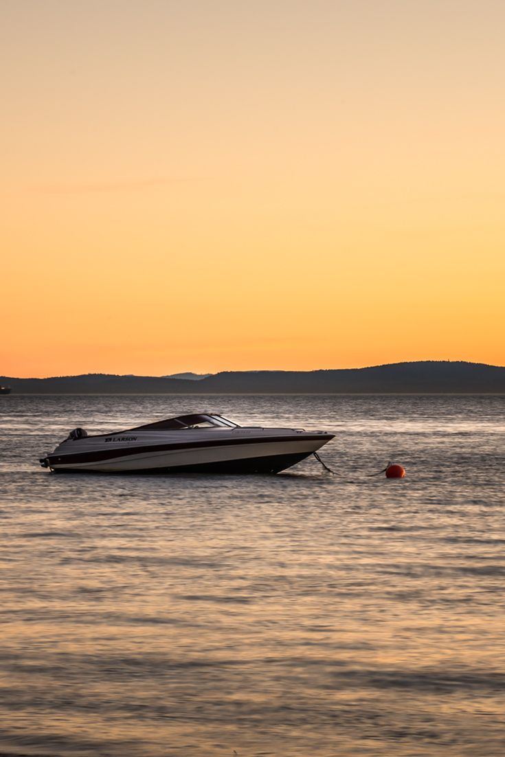 Free stock photo of a speedboat at sunset shot in Tsawwassen Beach. Download this free picture to use on blog or web article.
