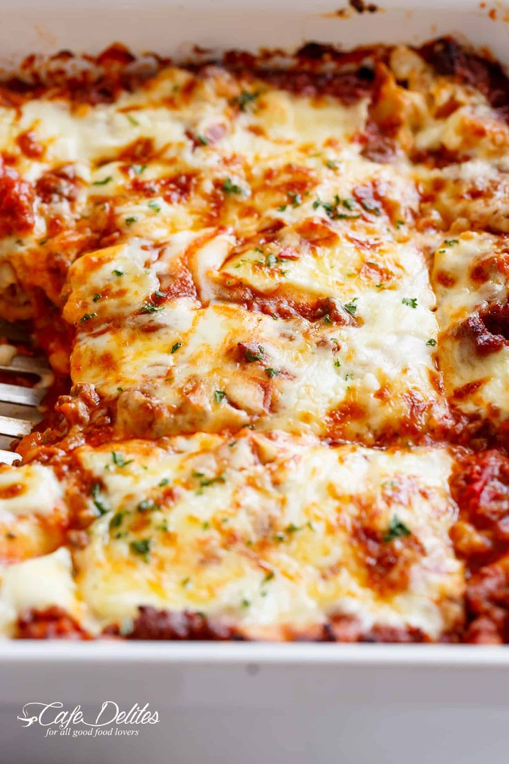 The Best Lasagna with a rich meat sauce and a creamy parmesan white sauce, plus the perfect amount of mozzarella cheese! NO ricotta cheese needed! | cafedelites.com