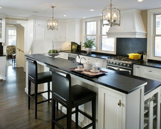 Black and white kitchen w clean, sleek lines, custom cabinets and rich hardwood floors #home #remodel #kitchen #bathroom #interiors  www.jimhicks.com