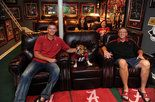 Leather theater seating, 5 TVs, bar, Legion Field turf carpet worth every bit of the $35,000 price tag.