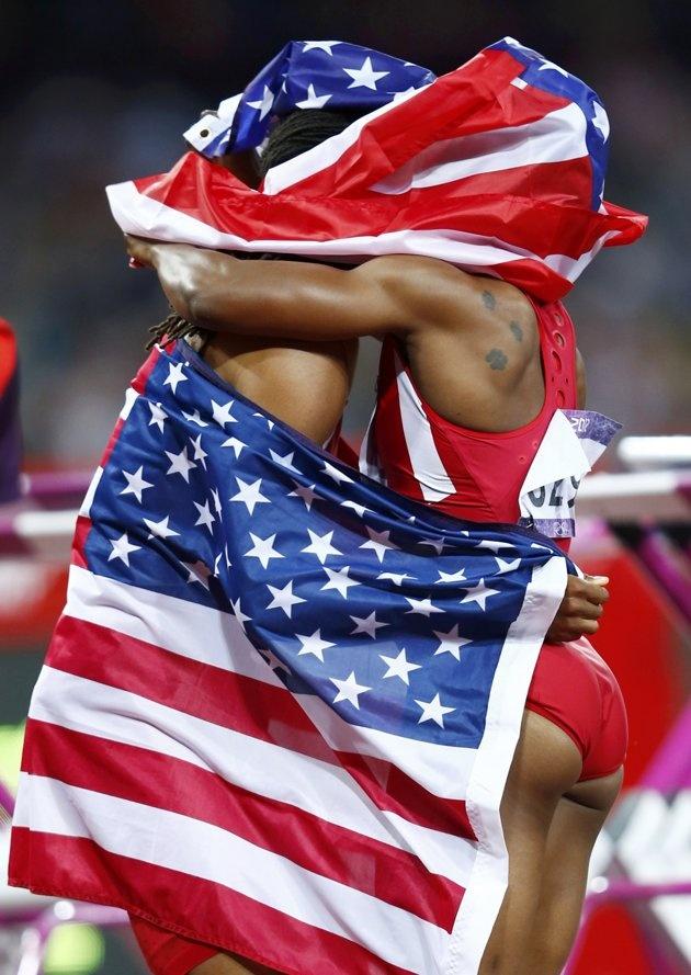 Jason Richardson of the U.S., who won second in the men's 110m hurdles final, hugs Carmelita Jeter of the U.S., who won third in the women's 200m final, during the London 2012 Olympic Games