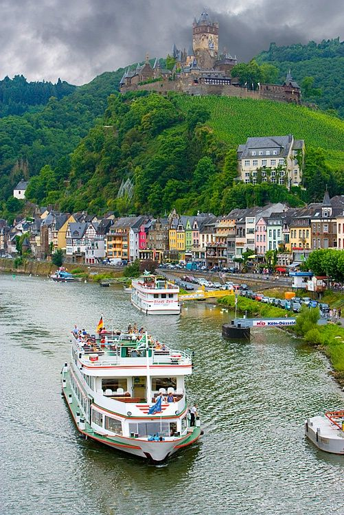 Cochem, Germany and the Mosel River with Cochem Castle in the background.