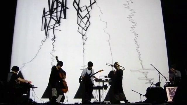 "SjQ++ is an audio-visual project formed in Kyoto,Japan in 2012 by Yuta Uozumi (piano/computer), Tadashi Yonago, (trombone/computer),Isao Nakagaito(guitar), Shuhei Otani(bass), Wataru Asada(Drums) and Ryo Kanda (visual/computer).   Originally, They started an improvisational music project named ""SjQ"" in 2001.  In the next year, their first piece ""meme?"" was released from cubicmusic Japan.    They compose their music using multi-agent system in real-time. Multi-agent syste…"