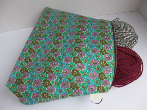 This nice and roomy fully lined zippered pouch keeps your things cute and organized. Perfect for your latest WIP (work in progress), or to store toiletries or other crafty projects. Use it as a small bag inside a big bag to keep anything protected, organized and easy to find.  A perfect gift for your loved one who is in to knitting or crocheting, or other crafty pursuits!  This project bag accommodates two 100g skeins of yarn + project. Its perfect for knitting shawls or baby clothes, and…