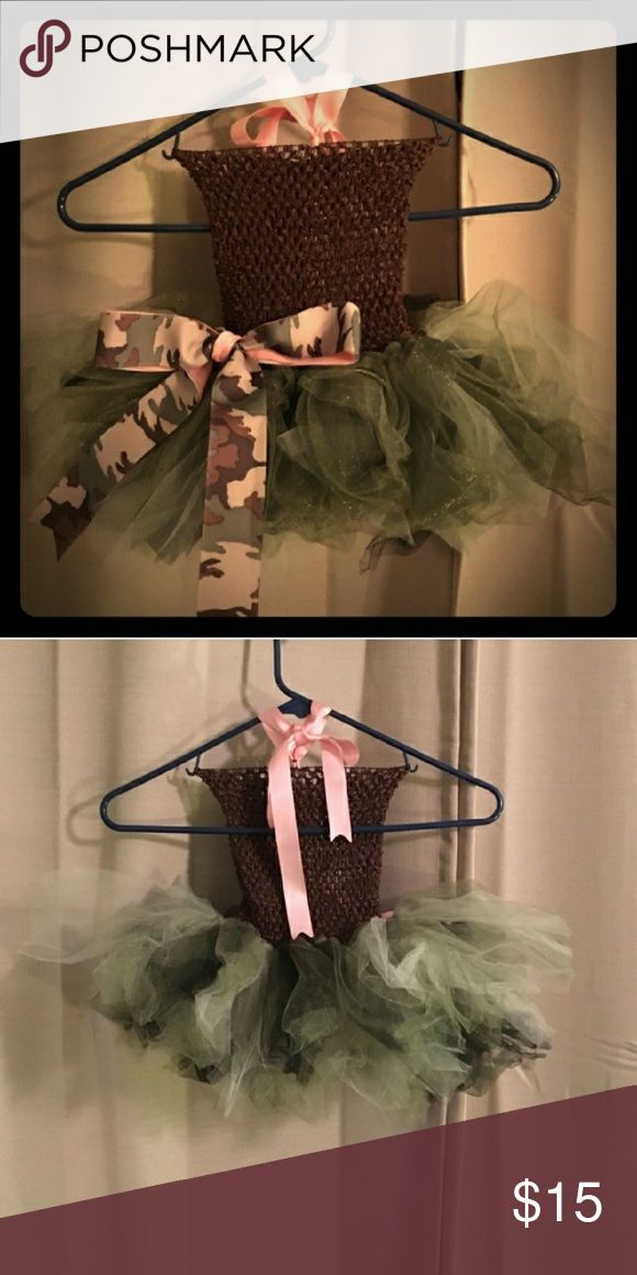 3-12 Months, Custom Made Camo Tutu This camo tutu is absolutely adorable! It was custom made and is in excellent condition. So cute for pictures. Dresses
