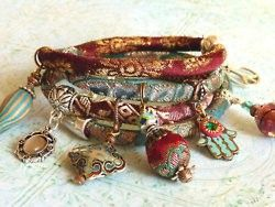 Memory wire bracelet wrapped in cloth with cloisonne charms. Great idea