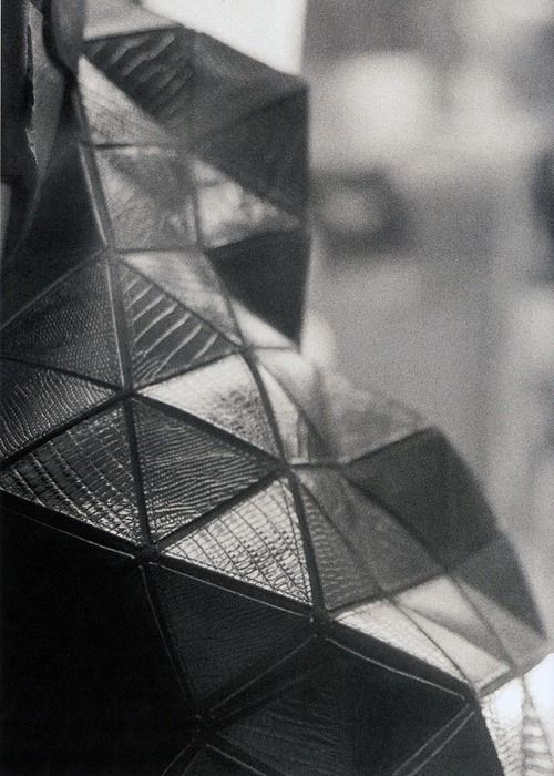 Geometric textile design with leather applique & tessellating triangle pattern; sewing; textiles for fashion // Gareth Pugh Fall 2008
