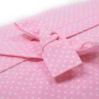 rose tint swaddling bag