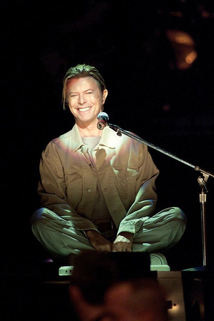 """This is Bowie opening the 9/11 heroes benefit concert in New York City. You will notice that he is sitting cross legged at the front edge of the station with a very small keyboard in front of him that he used as his only accompaniment. He opened with the archetypal """"America"""" by Simon and Garfunkel then went into """"Heroes"""" after thanking his local fire house. Apparently, Bowie was all over the city firehouses after 9/11 checking in with survivors just to see what he could do and how they were."""