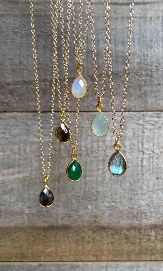 A brilliantly bezeled gemstone glides freely on a delicate cable chain. Natural, teardrop shaped gemstone is available in your choice of gemstones.