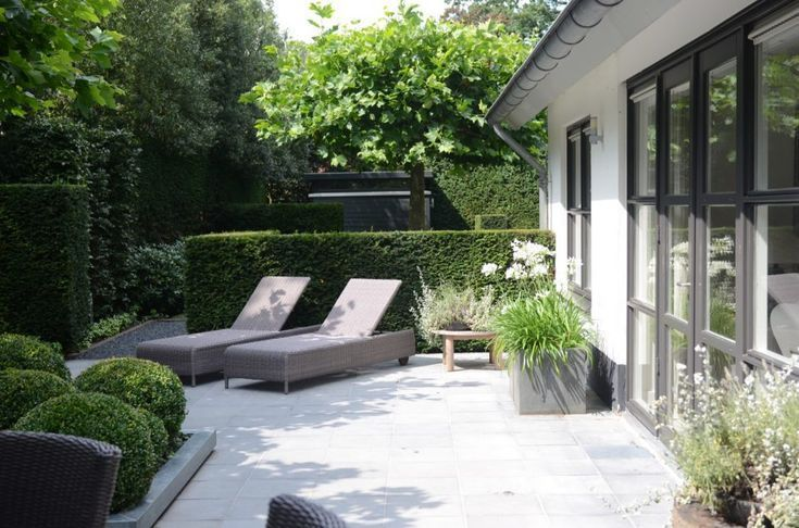 Modern garden design with sun loungers #garden design #left chairs #modern #terracedesign