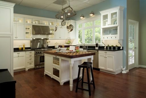 Palladian blue by Benjamin Moore on the walls contrast with white cabinets and dark countertops