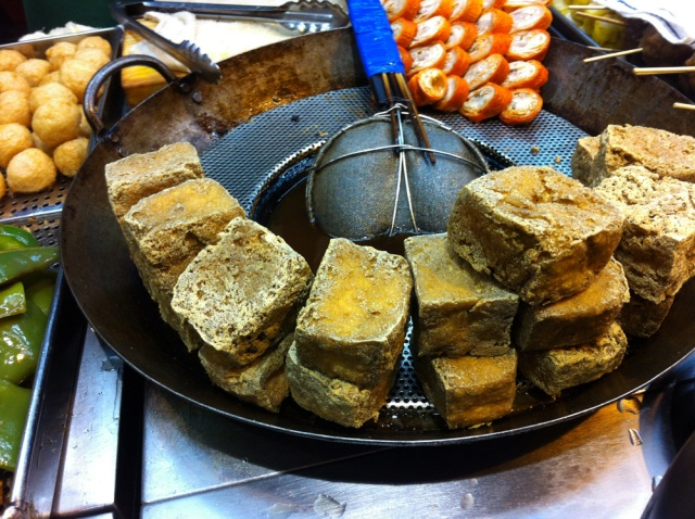 Delicious stinky tofu.  http://myamusedbouche.com/2012/09/15/a-recent-run-in-with-stinky-tofu/