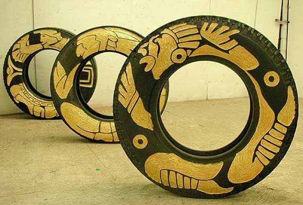 Tires recycled with carved and painted designs - art by Betsabeé Romero     http://www.tentimesone.com/bringing-tires-from-trash-to-craft-the-work-of-betsabee-romero/