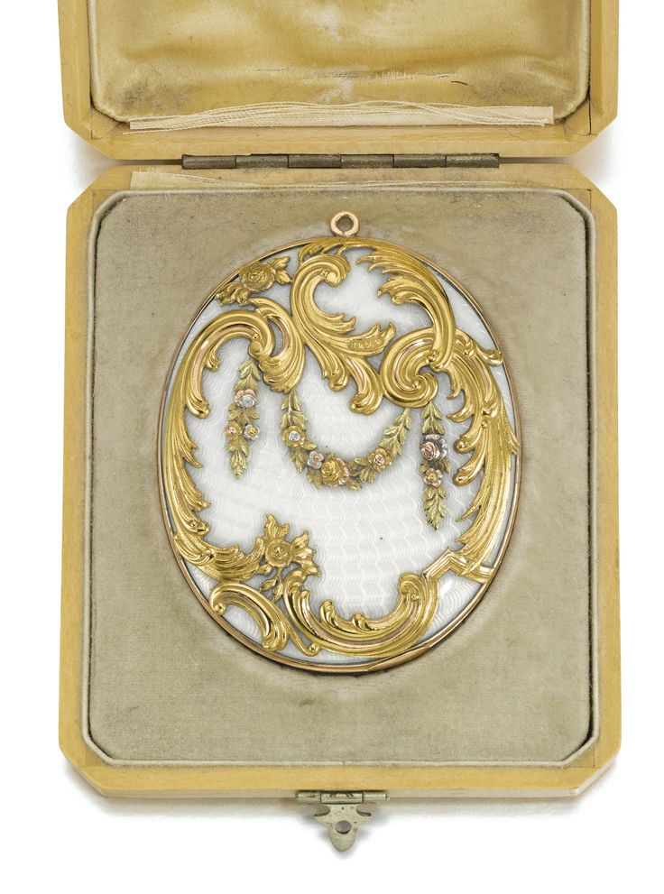 A Fabergé gold-mounted enamel pocket mirror, workmaster Michael Perchin, St Petersburg, 1895-1899. Oval, the surfaces of translucent white enamel over banded wavy sunburst engine-turning, the front applied with rocaille scrolls hung with four-colour gold floral garlands, pendant loop, the interior fitted with a bevel-edged mirror.