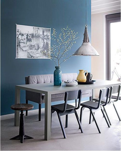 Dining room with blue wall and industrial lamp
