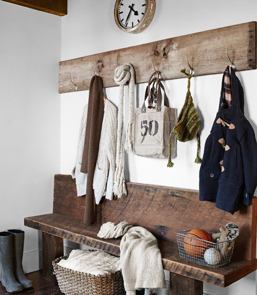 Rustic entry bench and hooks - makes for a casual but still organized mudroom. Wall space is used well with the large plank of wood and hooks, you can note what time it is also. The bench is perfect, sit and put on or take off shoes and then there are containers to contain the smalls. Love it. #organizing_for_tranquility
