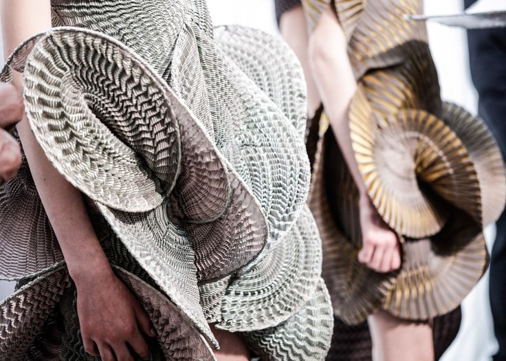 Voluminous dress made from Japanese changeant fabric hand-pleated in different directions, Iris van Herpen AW16