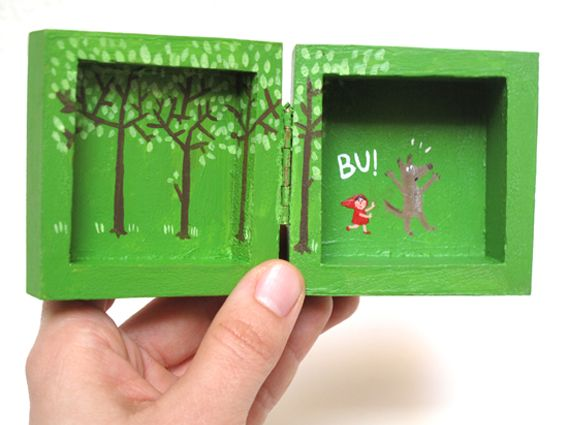 two tiny canvases, hinged together to make a tiny book...very cute and very funny!