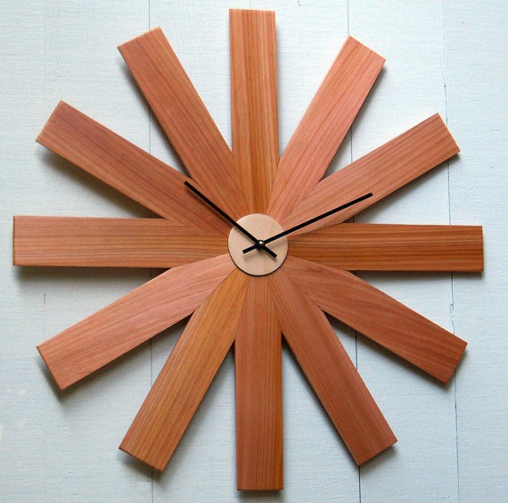 Sunburst Fan Clock by djwubs on Etsy, $65.00. No offense, but I could make this myself with the spare wood in my dad's work room for less than $65.