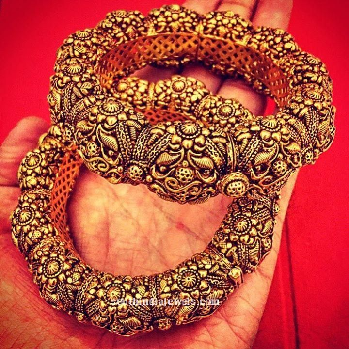 Gold Kada bangle design from Amrapali Jewels. For inquiries please contact 91 141 5191100.