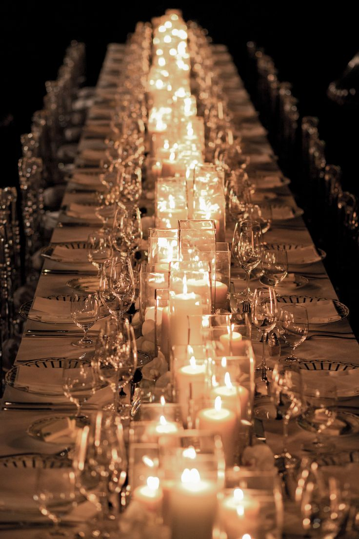 Candles are cost friendly and go a long way in creating ambiance. Sophisticated Wedding Reception table decor. Love this.