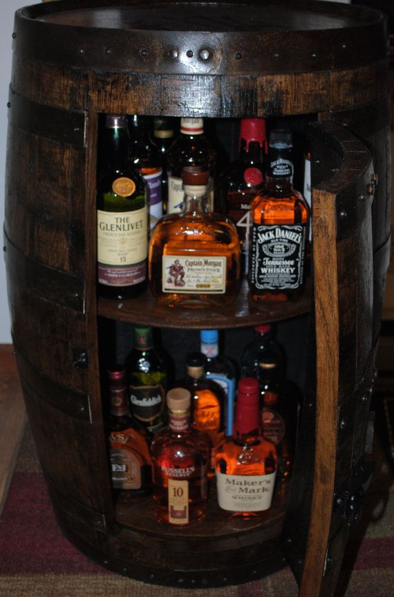 whiskey barrel liquor cabinet with double lazy susans and removable door