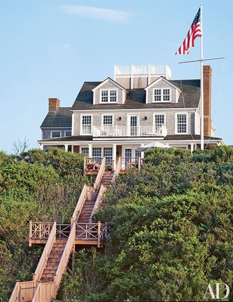 This charming Shingle Style home on Nantucket, Massachusetts, sits in on a pristine oceanfront plot.  Pin it.