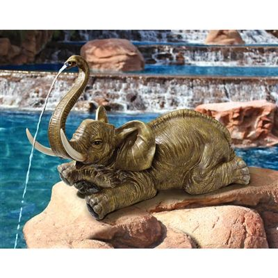 """""""Sprinkles, the Elephant"""" Piped Spitter Statue.  Lifting his trunk for luck and to share a good-natured cascade of sparkling water, Sprinkles, our charismatic elephant arrives piped and ready to claim the place of honor in our garden, pool or pond. #elephant #spitterfountain #fountain #statue"""