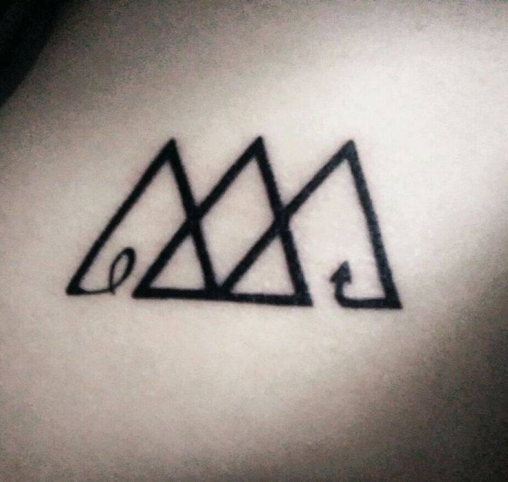 The three triangles represent the past, present, and future of friendships. Scorpio and Virgo friendships in a tattoo.