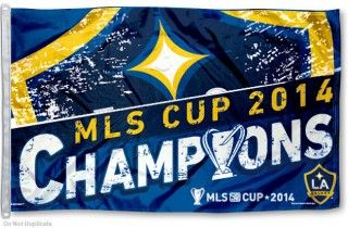 LA Galaxy 2014 MLS Cup Champs Flag measures 3x5 feet and offers Los Angeles Galaxy logos. LA Galaxy 2014 MLS Cup Champs Flag is made...