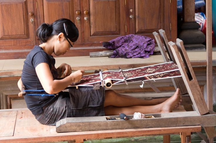 Weaving using a traditional back tension loom in Bali.