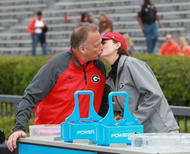 Georgia Bulldogs coach Mark Richt, left, kisses his wife Katharyn before Georgia's game against the Auburn Tigers at Jordan-Hare Stadium Sat...