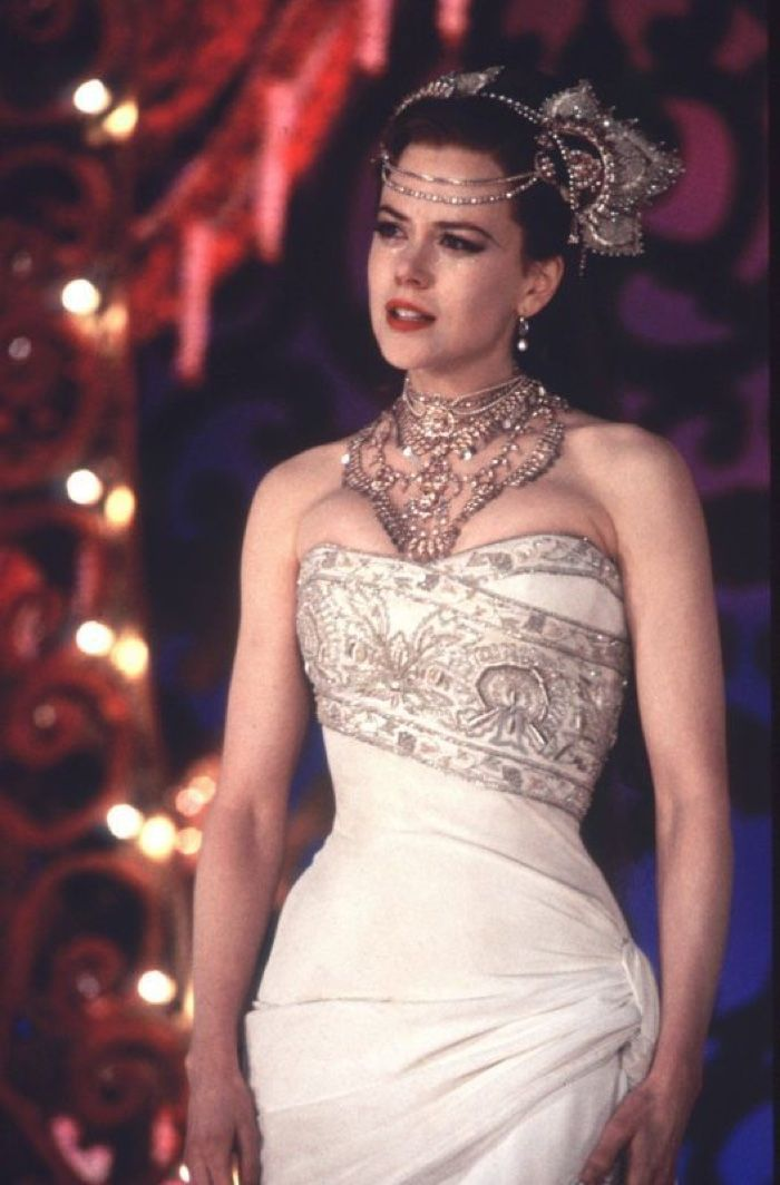 Nicole Kidman (Satine) wears a white wedding dress embellished with crystal in the finale number